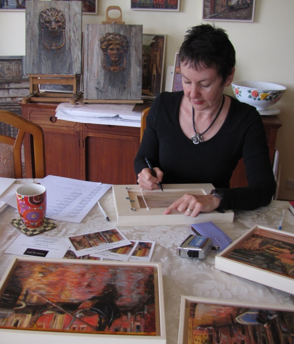 Artist, Marion Langford, at work...finishing touches on paintings for La Serenissima Exhibition